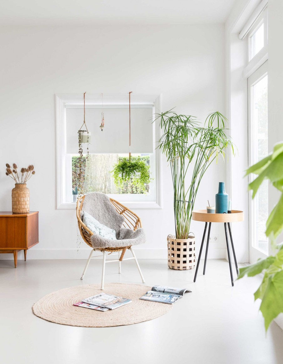 All White Interior Filled With Mid-Century Modern Furniture