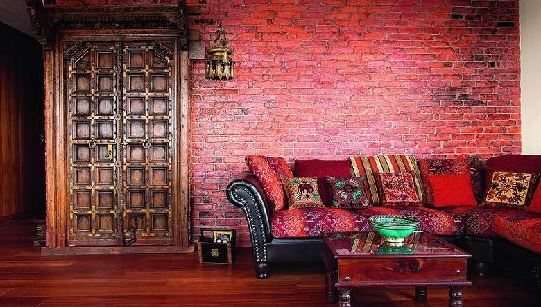 Bold Red Living Room With Original Indian Doors