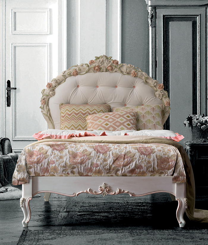Luigina bed with a hand-carved floral headboard completed with floral bedding