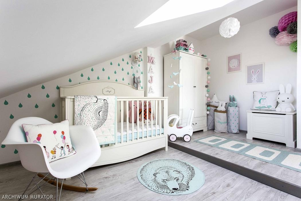 Scandinavian Girl's Nursery Design With Touches Of Mint