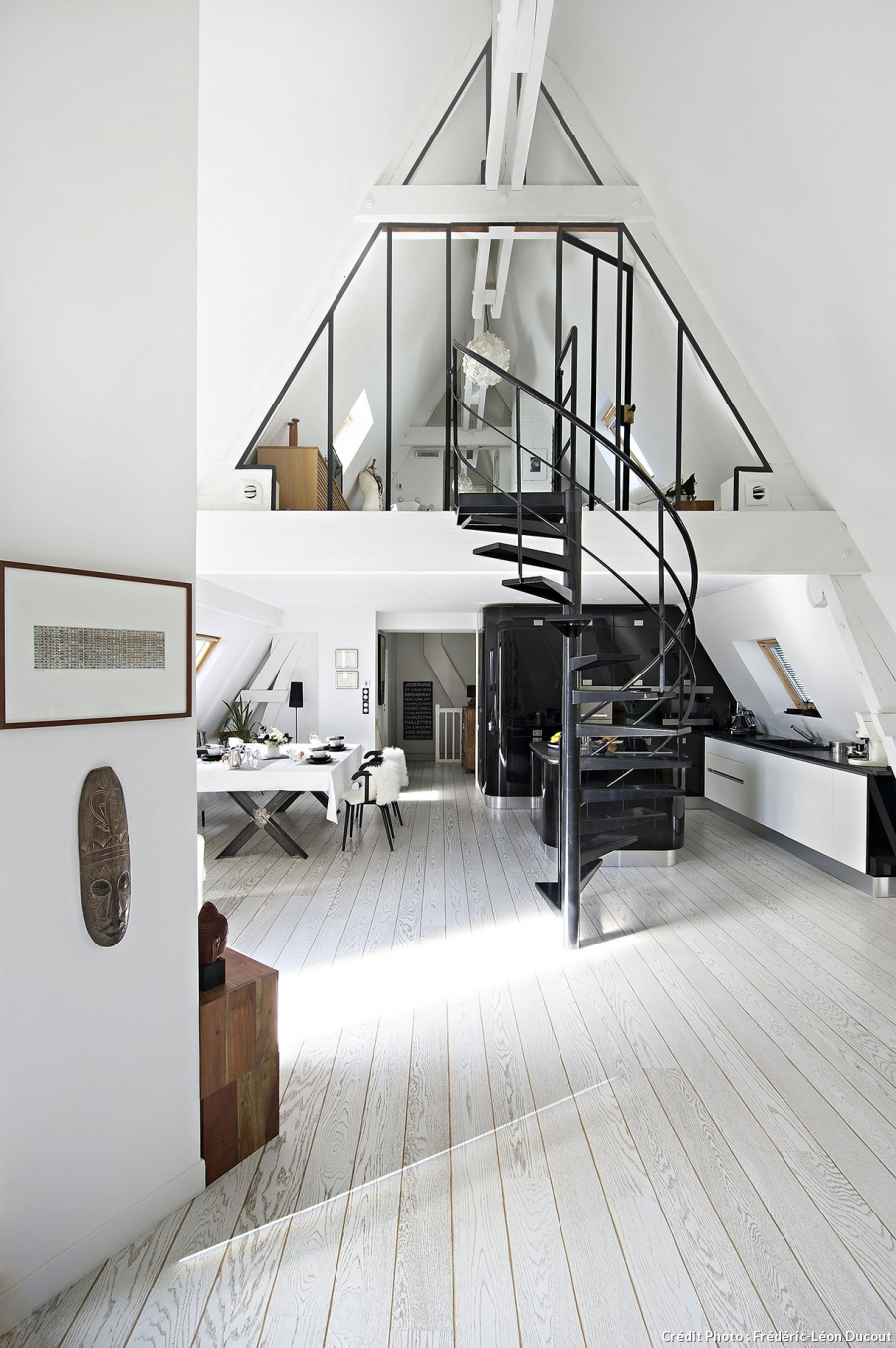 This attic apartment was divided into two floors sepaarting the public and private area