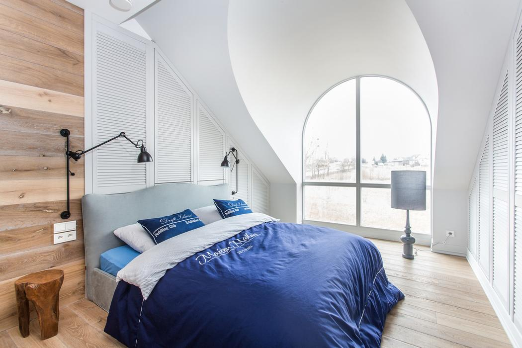 This modern attic bedroom is decorated in
