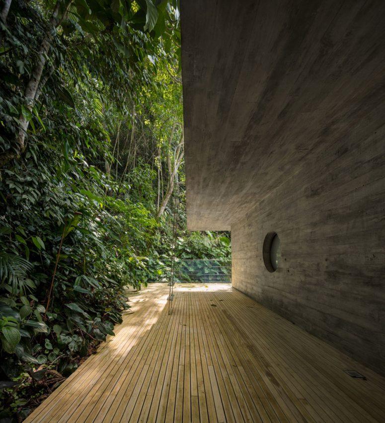 A wooden deck runs around the house