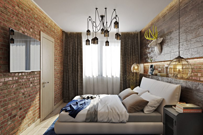 Though the bedroom is small, there are a lot of stylish touches like a brick wall or an industrial metal chandelier
