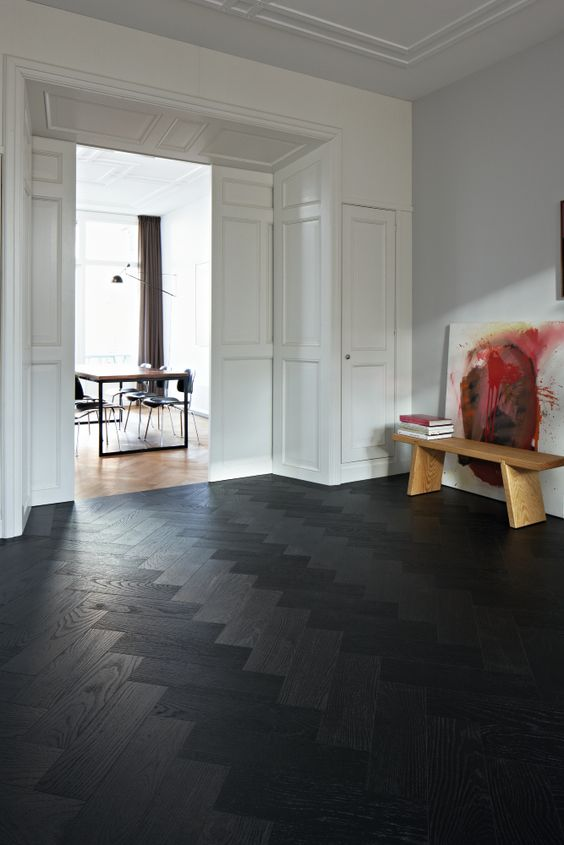 Black Patterned Hardwood Floor For An Entryway