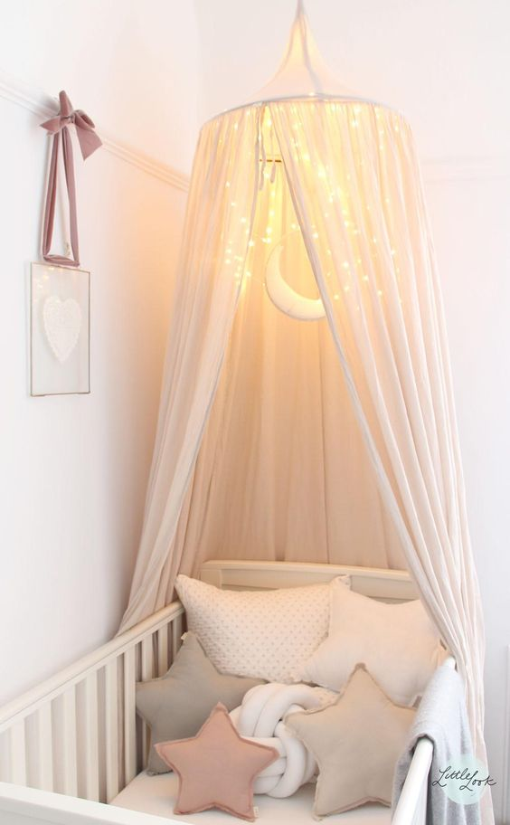 pastel crib cot with a LEDs canopy
