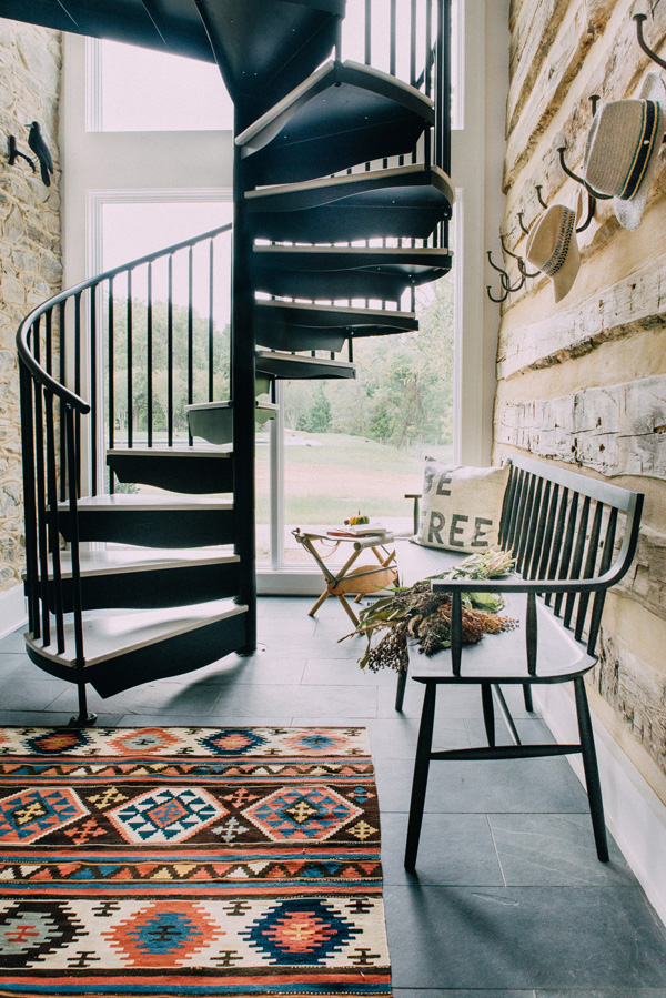 A blackened steel staircase in the hallway hints on other industrial touches in the home