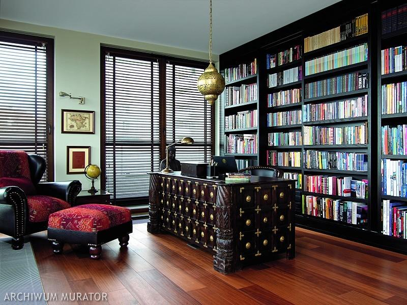 The home office has a double library and a traditional Indian desk