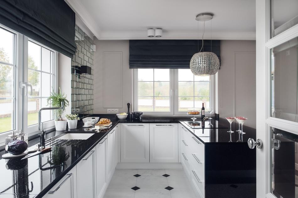 The Kitchen Cabinets Are White With Black Granite Countertops A Touch Of Glitter