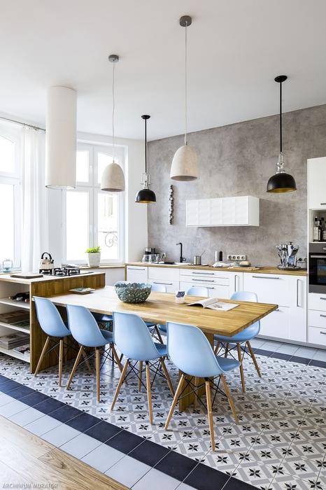 The kitchen is simply white, with light-colored wood countertops and light blue chairs