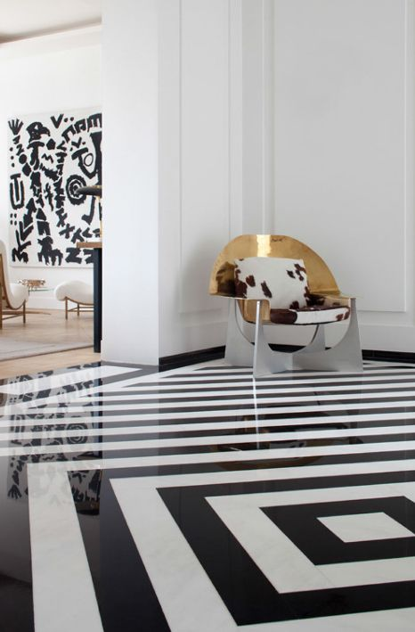 black and white stripe floor and dramatic metal chair