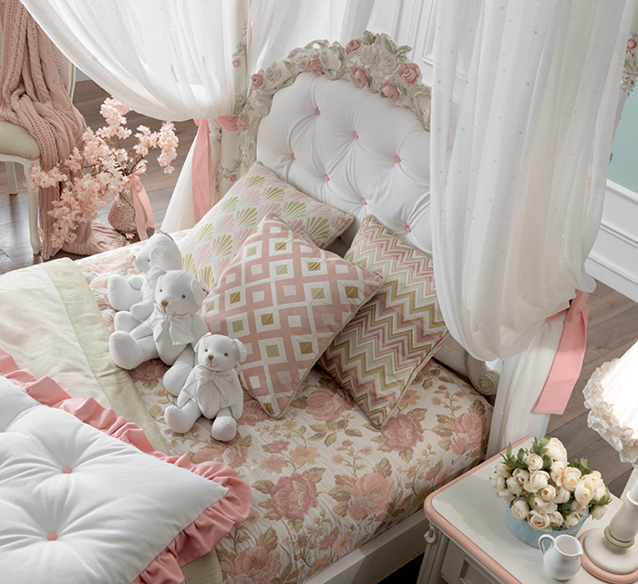 Luigina bed charms with a hand-carved floral headboard and 4 canopy curtains to create privacy