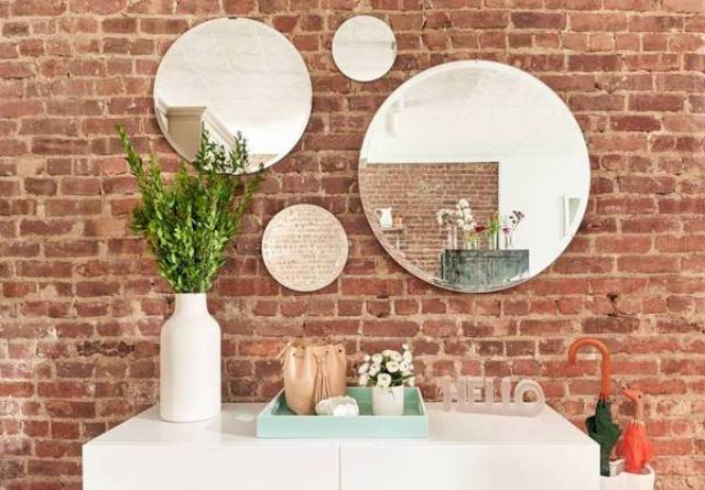 The exposed brick wall gives the space charm and character
