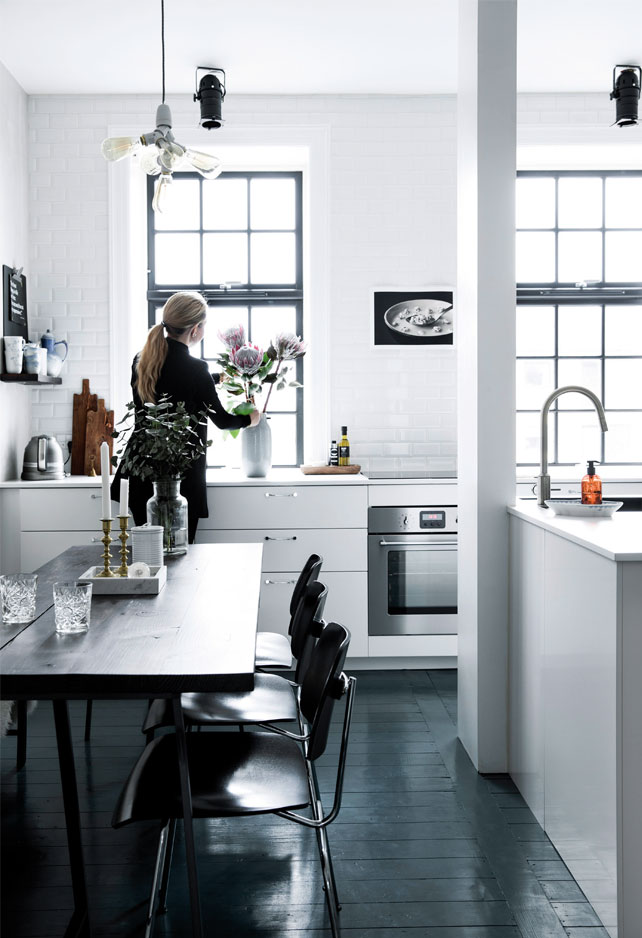 The kitchen furniture is a mix of modern items and flea market finds