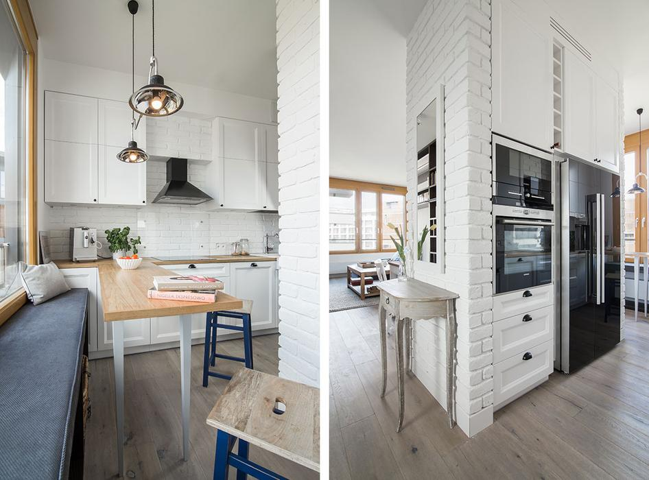 The kitchen is tiny, and the worktop is extended to make a dining table by the window seat