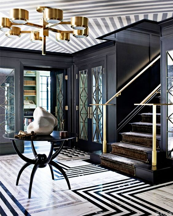 geometric marble graphic floors in a black and white patterned entryway