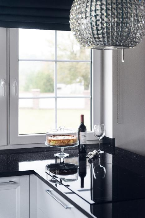 a beautiful rhinestone chandelier looks as if it u0027s right from the 1920s elegant art deco kitchen design with glam touches   digsdigs  rh   digsdigs com