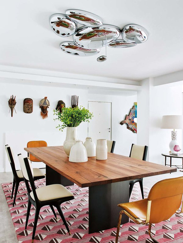 A large bubble chandelier marks the dining table