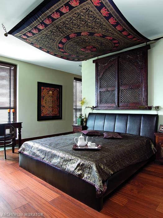An original rug is hug as a canopy in the bedroom, and there's a Nepal mandala on the wall