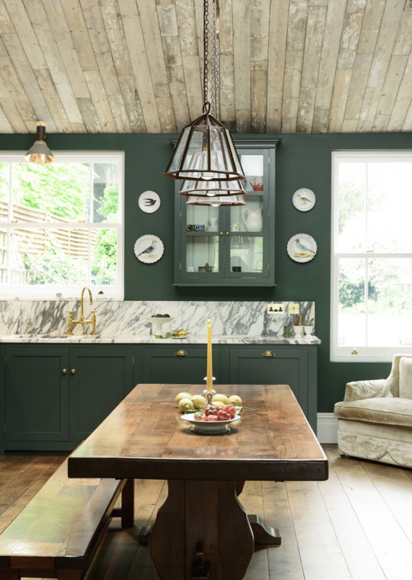 The dining set, the floors and the ceiling are clad with rustic warm-colored wood to give the kitchen a cozy look