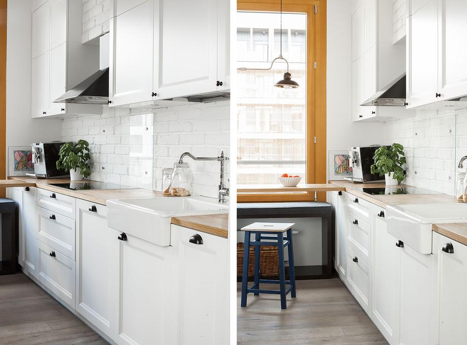 The kitchen cabinets are white ones with a mid-century modern feel