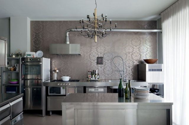 The kitchen is equipped with professional steel parts but still it has a comfy family character