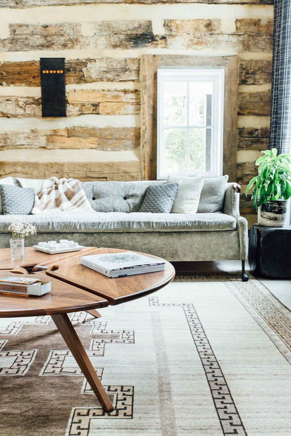 The walls are covered with the same reclaimed wood for coziness