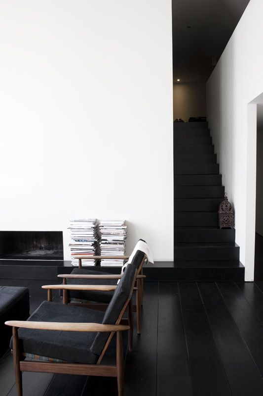 black wooden floors here are an important part of monochrome decor