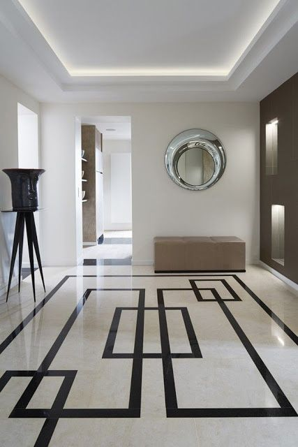 geometric stone floors make this entryway scream style