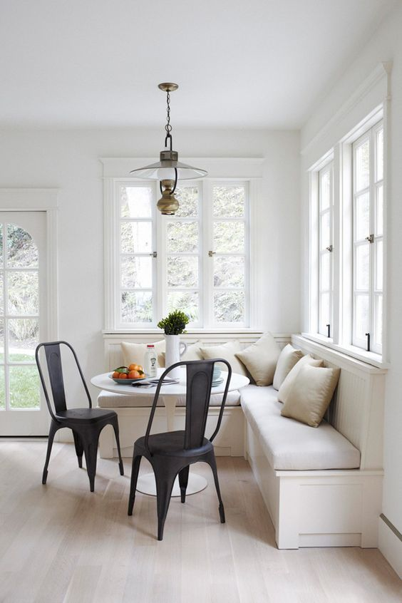 modern neutral breakfast corner with black chairs