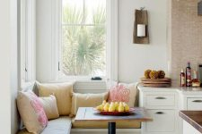 06 super small breakfast nook with patterned pillows