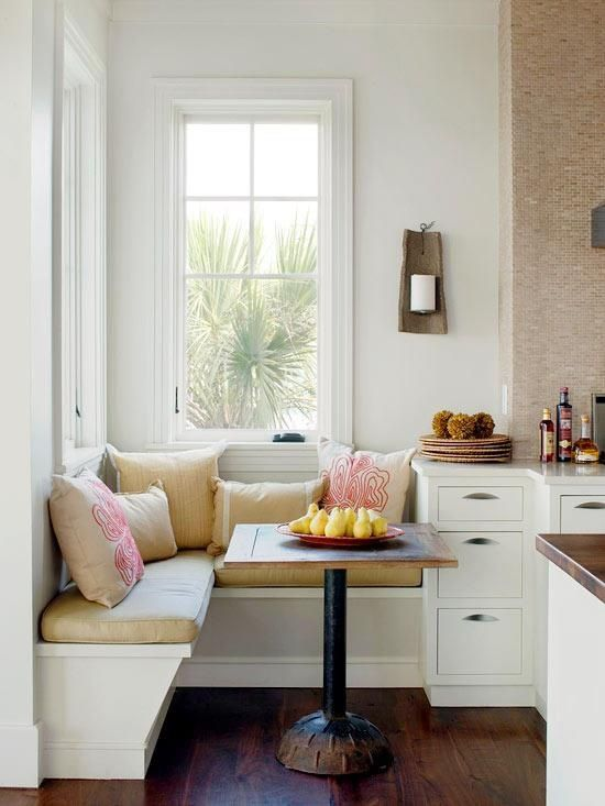 super small breakfast nook with patterned pillows