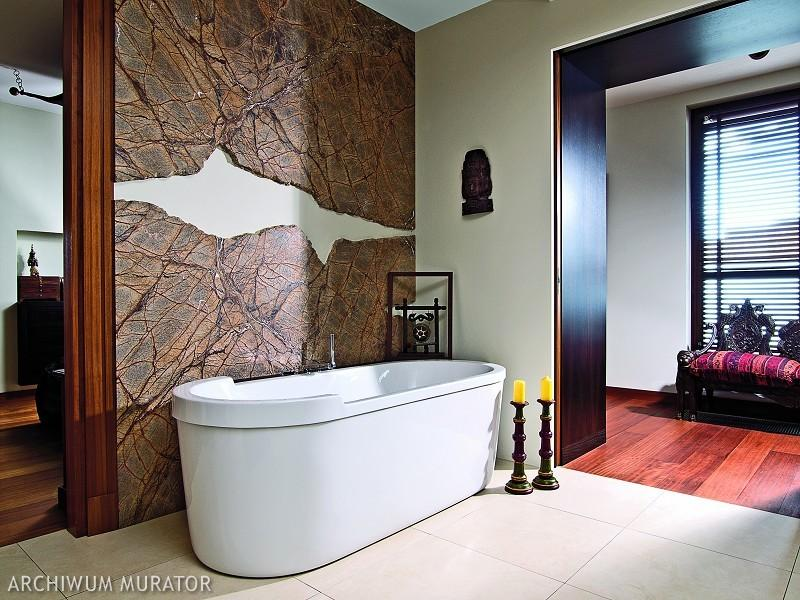 The bathroom is clad with Indian stone