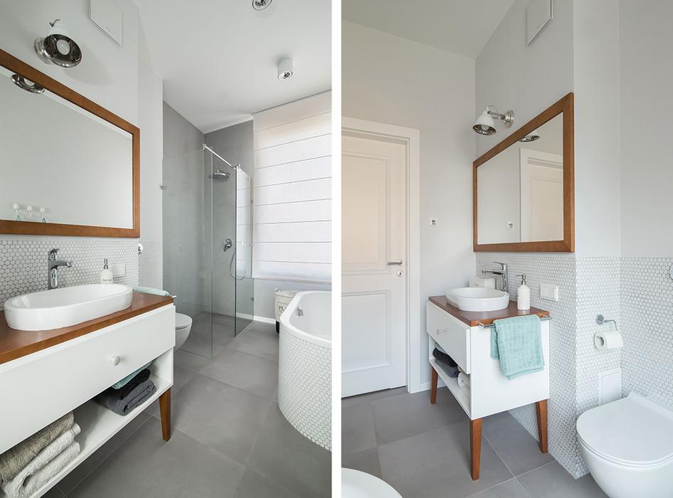 The second bathroom is a white one with natural wood details