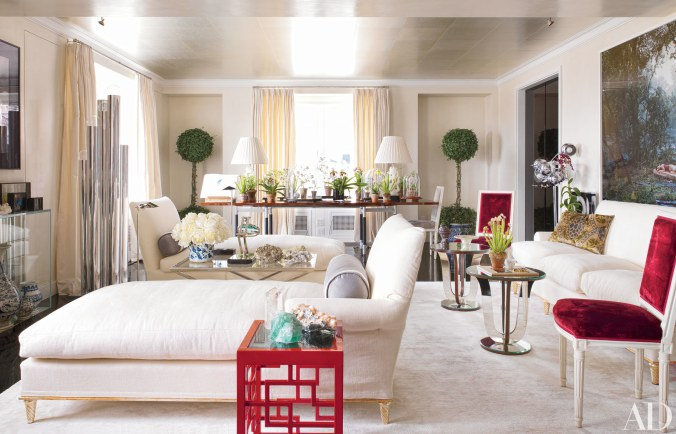 08 Small doses of color punctuate the room, most notably the scarlet lacquer side table and velvet upholstery of the side chairs