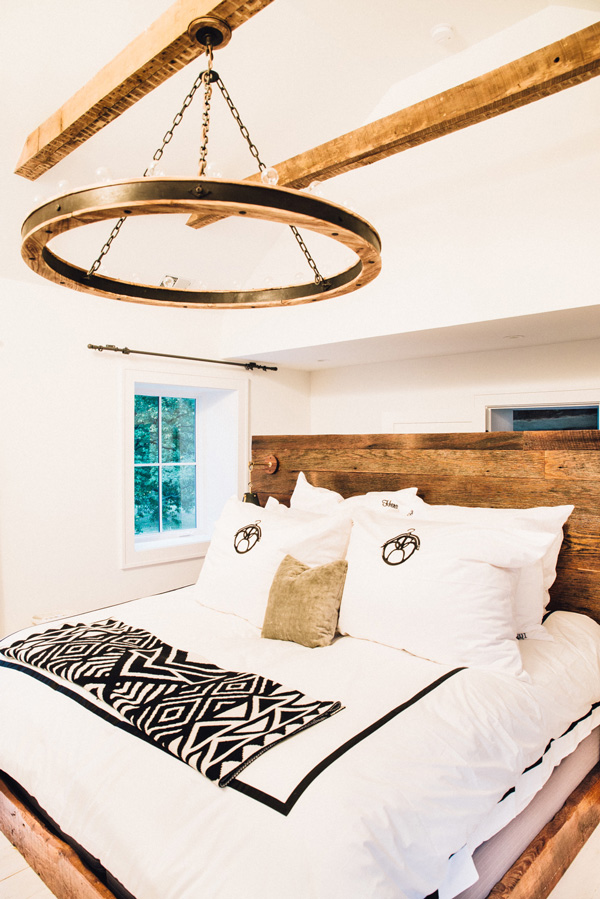 The master bedroom is decorated with reclaimed wood