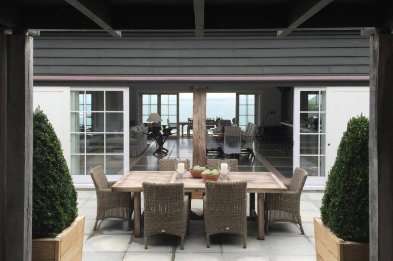 The patio can boast of a cool dining space with woven furniture