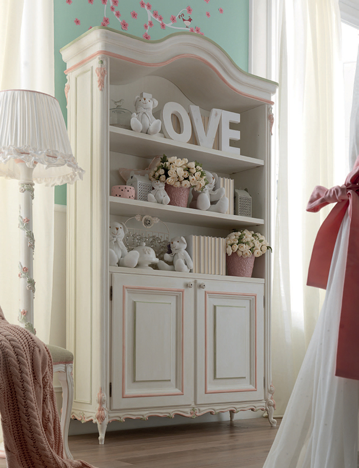 The Bookcase looks vintage and chic with its pink trim and hand-carved edges