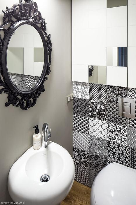 09 The toilet is decorated with differently printed tiles and a vintage mirror