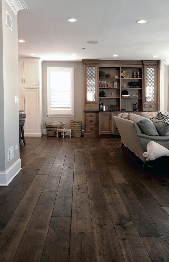Dark Walnut Floors In This Living Room Have A Noble Weathered Look