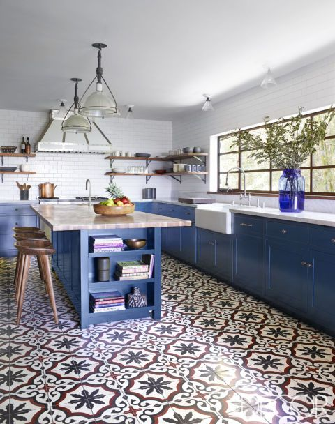 patterned mosaic tiles attract attention in this blue kitchen