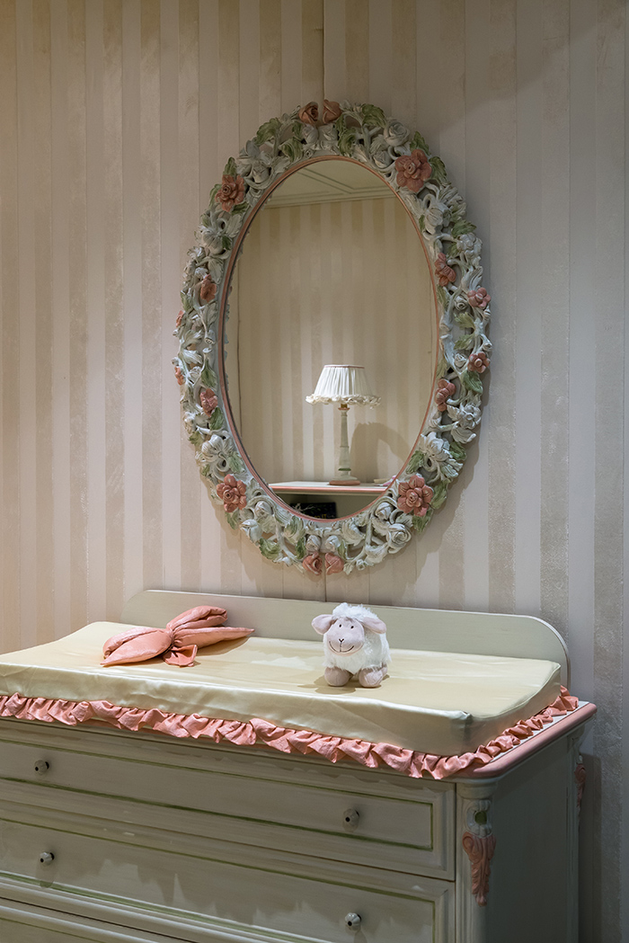 If you are decorating a nursery, you'll need this changing table and a mirror above it