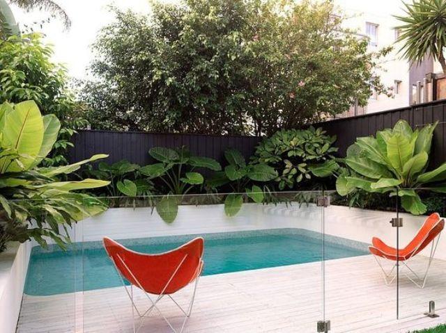 frameless glass fence for a modern pool