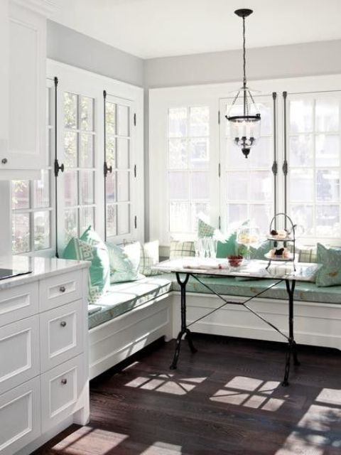 vintage corner breakfast nook with turquoise accents