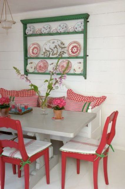 Glossy red and green dining area in a summer house