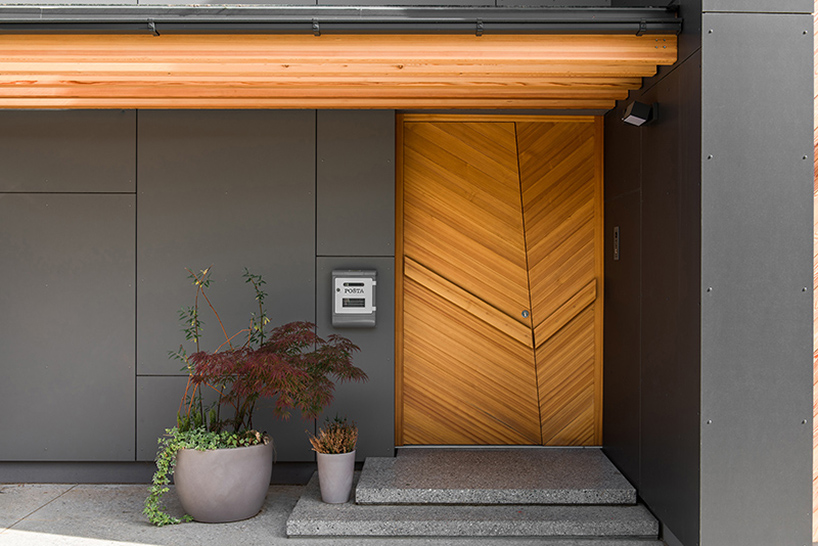 The entrance can boast a gorgeous modern wooden door in the same shade as screens