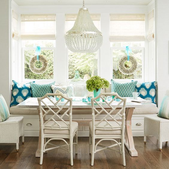 vintage-inspired neutrals and turquoise breakfast nook with storage drawers