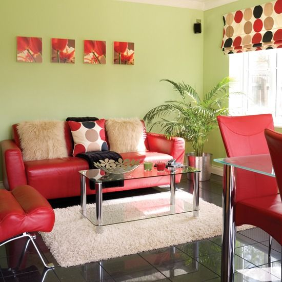 Bold red makes a statement against fresh green walls in this living room