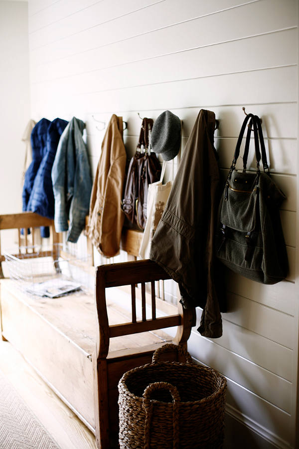 The simplified mudroom provides a convenient spot to drop your coat and bags after a busy day