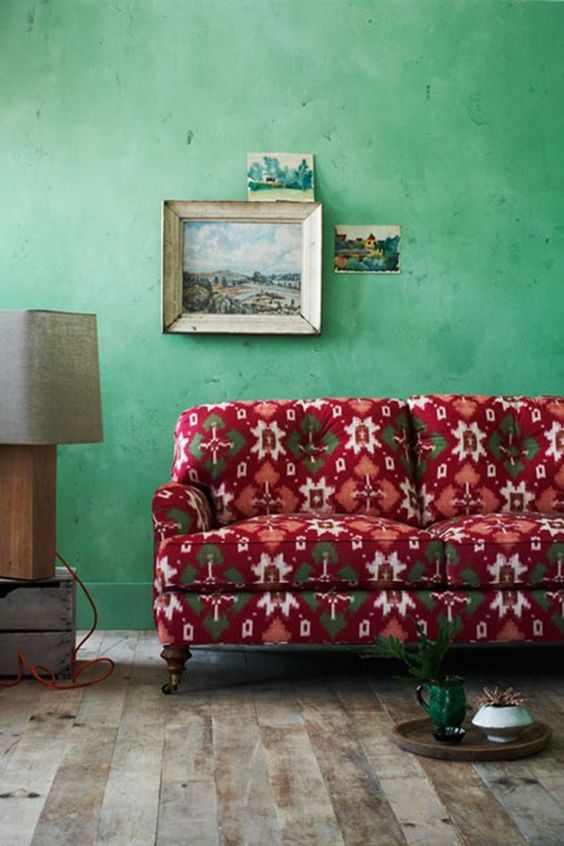 Light Green Walls And A Red Vintage Sofa